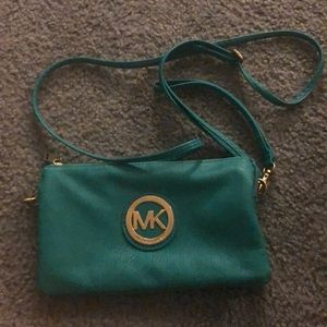Micheal kors blue off the shoulder or clutch